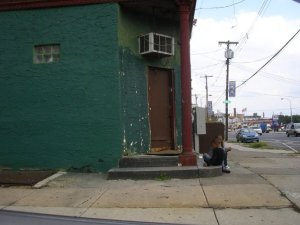 Kids Sitting on Steps of Dilapidated Building